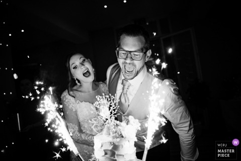 Wedding Photography from Burg Rheinstein | Black and white wedding cake cutting photography of bride and groom