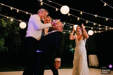 villa cimbrone ravello wedding reception photography of the groom receiving cake in his face as the bride looks on