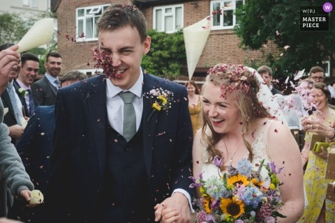 Birmingham wedding reportage photography of bride and groom Confetti wammy after the ceremony