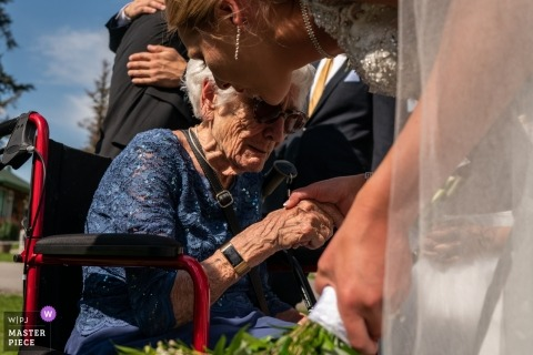 Wedding Photography from Jasper Park Lodge, Jasper, AB, Canada | Bride and her grandmother after the ceremony, having a tender moment together