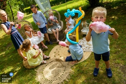 Outdoor Wedding Reception Photography at De Lutte, Jan Wesselinkhoes - Kids eating candy cotton, with joy