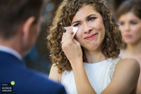 Deer Park Villa, Fairfax, California wedding venue picture | The bride wipes her tears during the wedding ceremony.