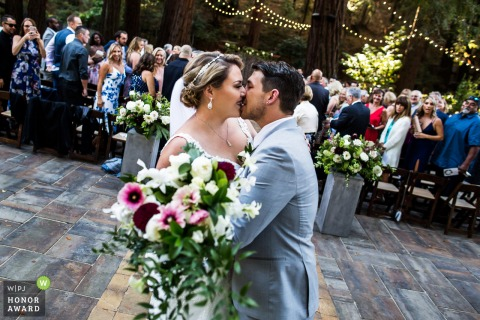 San Francisco outdoor wedding venue photography | California bride and groom kissing after the Ceremony