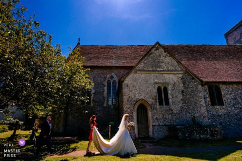 Barham, Kent, UK wedding reportage photographer | Bride arrives at church for her wedding ceremony