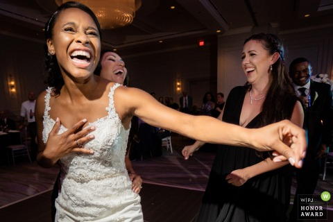 JW Marriott Buckhead Atlanta Georgia wedding venue reception photo | Super happy bride on the dance floor