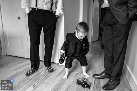 Montreal, Canada Wedding Photographer - a toddler gets ready on parents wedding day