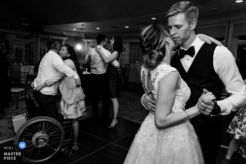 Point Lookout wedding photography in ME - A bride dances with the groom and her guests at their Maine wedding