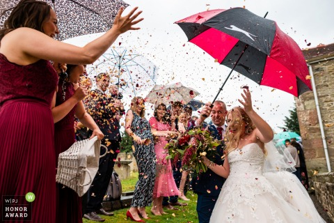 Ellesmere, UK bride and groom photo during confetti run