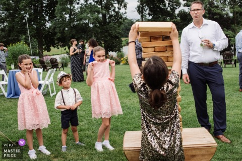 Chesterfield New Jersey wedding photography of Giant Jenga game at outdoor wedding reception on the grass