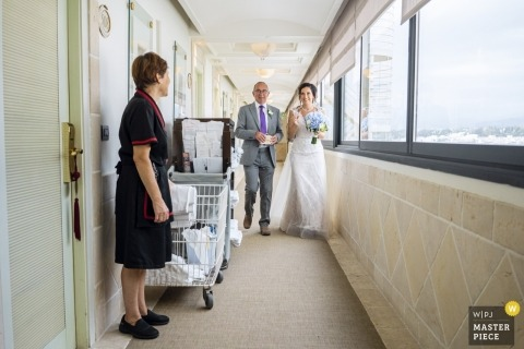 Marbella, Hotel Melia Wedding Photography - Image contains: bride, father, housekeeper, room doors