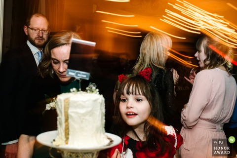 Photo at the reception hall in Kingston | Little girl sees the wedding cake