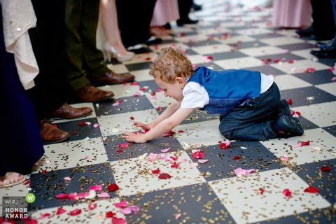 Southdowns Manor, Hampshire, UK wedding venue photo | Confetti fun for the dressed up boy