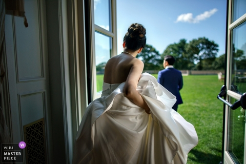 Oheka castle wedding photography - bride getting ready with dress