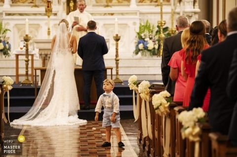 St. Mary's Church, Charlestown, Massachusetts - Wedding Photography - Ring bearer in aisle during ceremony