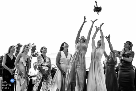 SAINT TROPEZ private chateau wedding photo of the bouquet toss in black and white