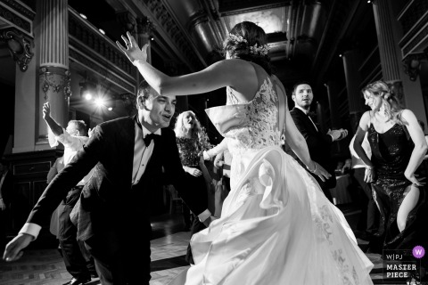 Bride and groom dancing on the dance floor at their Bragadiru Palace reception.