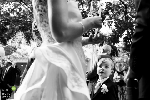 Bragadiru Palace wedding venue photography from outside | one of the kids is fascinated by the bride