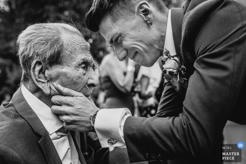 Wedding Photography from La Finca de Villanueva - Groom greets his grandfather
