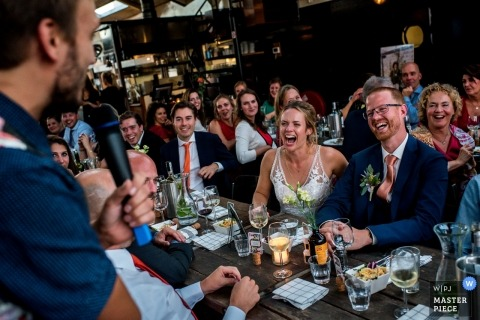 Reception Photography at Pont 13, Amsterdam - The reactions to the speech of the best men at the wedding.
