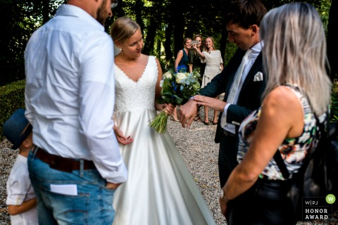 Kasteel Wijenburg, Echteld, The Netherlands wedding venue photo from outside | While the bride and groom receiving their best wishes after the ceremony, it's time for the sisters of the groom to take a selfie.