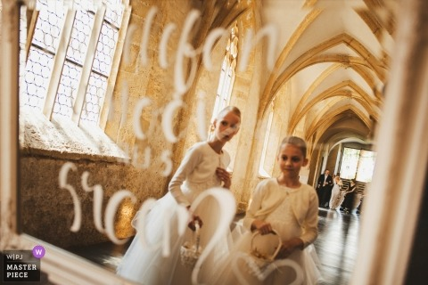 Dominikanski monastery Slovenia Wedding Photographer - The shoot was taken in the mirror while, the wedding planer helping the bride walking