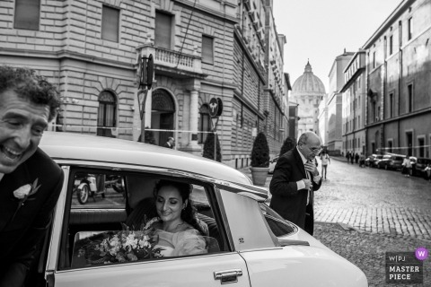 Santo Spirito in Sassia Church - Rome Wedding Ceremony Photography of Bride arrival and still in the car