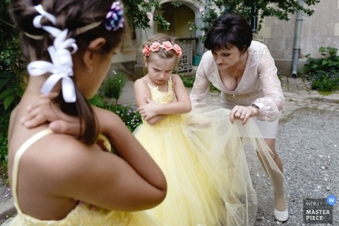 Wedding Photos from Chateau Allure du lac | The girl isn't happy her grand'ma adjusts her dress