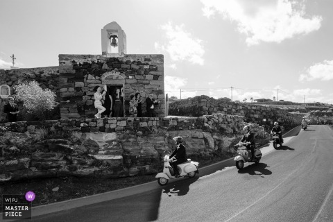 Wedding Photography from the Ceremony in Pantelleria Church - The original arrival for the groom and groomsman in Vespa