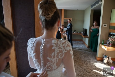 Turkey Hotel Photography on Wedding Day | Groom and friends watch bride while she is putting on her dress