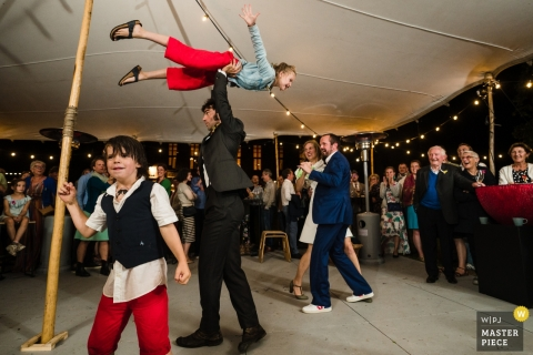 Wedding Photography of Children at Grez Doiceau - Flying Kids on the Reception Dance Floor under the Tent