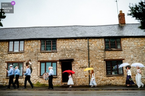 Brackley, Northamptonshire, UK Wedding Photographer - The bride walking to church, led by a band.