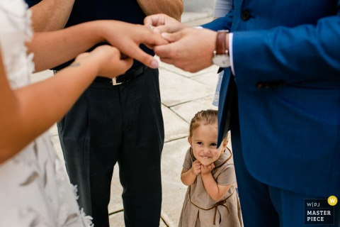Wisconsin State Capitol Wedding Photographer | Groom's niece smiles as the bride and groom exchange rings