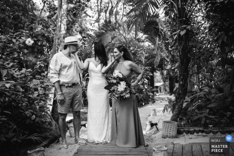 Pousada Bahia Bonita - Trancoso - Bahia - Brazil Wedding Venue Photography | A minute before the bride enters the ceremony, she has her hands kissed by her parents.