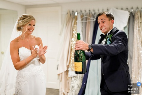 Wychmere Beach Club Wedding Venue Photography | The groom opens bottle of champagne