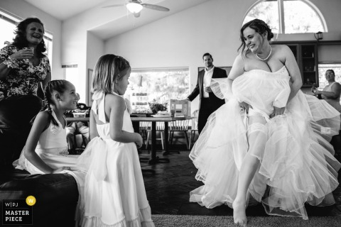South Lake Tahoe Wedding Photography - The bride trying to explain to children what stockings are.