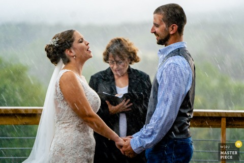 Wolftrap Farm, Gordonsville VA Wedding Photo | A bride shouts her vows over the sounds of the pouring rain