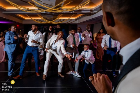University of Maryland Hotel, College Park, MD Wedding photography of a kid and a groomsman diving for the garter