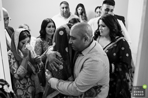 London England Wedding Reportage Photographer at the Bride Home | Everyone is emotional and trying to hug the bride to say good bye.