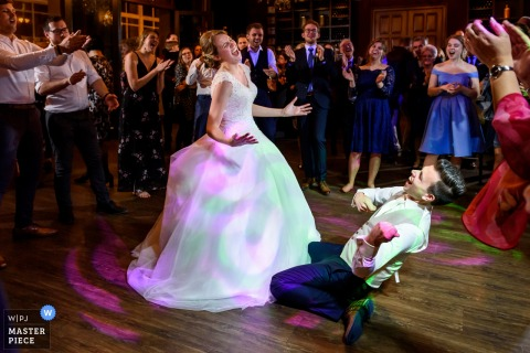 Netherlands wedding photography of the couple's first dance that went pretty wild and guests cheered