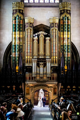 UK wedding reportage photo | Bride arriving to walk down the aisle at Eton College Chapel