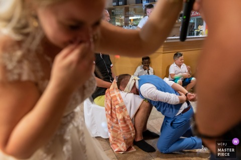 Celje, Slovenia wedding reception photography - humor, bride, groom, blindfolded, joke, prank