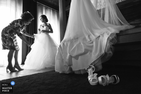 Lyon Hotel Wedding Photography - The mam of the bride is helping her with the last touch to get ready