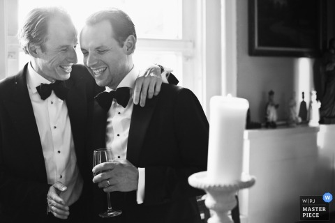 Lyon Wedding Reception venue photographer - The groom on the right is enjoying the moment with one of the best men
