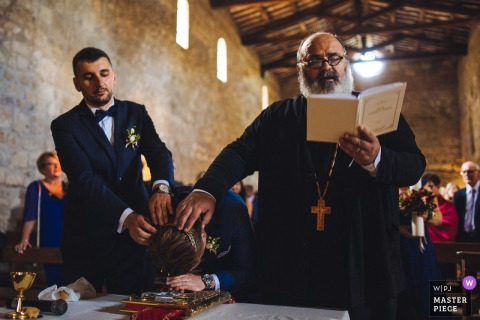 Church Photography from the Ceremony - Abbazia San Giusto - bow to the holy book