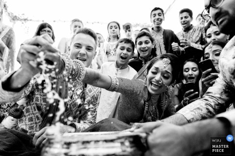 Wedding Photographer for Froyle Park wedding venue, UK - Hindu wedding game of ring fishing