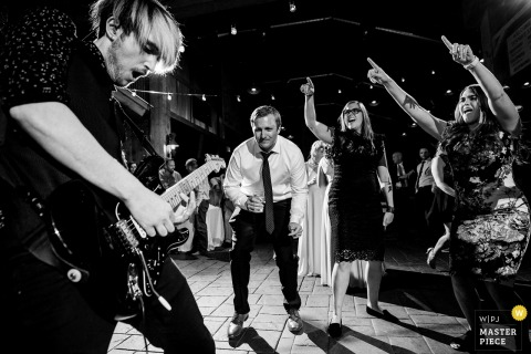 Tenmile Station, Breckenridge, CO | Candid Wedding Photography | The wedding guests getting down to the live band during the reception.