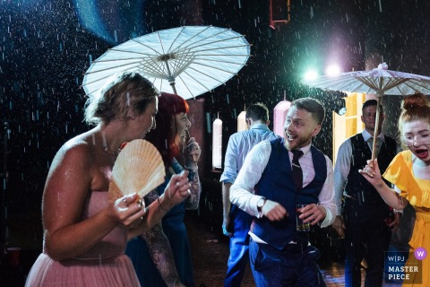 Wedding photos from Chateau de Bijou, France - dancing in the rain