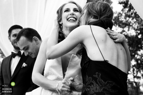 Bragadiru Palace wedding venue photography | Bride and godmother hugs each other at the end of the ceremony