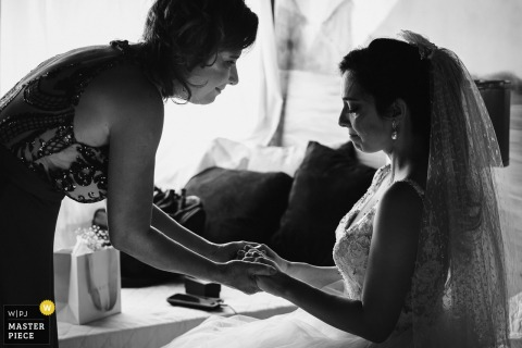 The last moment between mother and daughter before the ceremony. The connection between them is unique and the emotion takes over. | Wedding Photography from Solar da Palmeiras - Ilhada Gigóia/RJ - Brazil