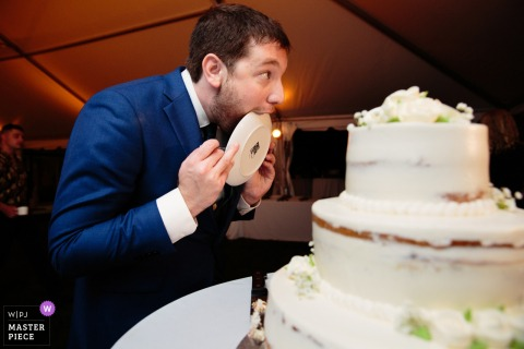 Wedding at Northport Long Island family home, Reception Photography - The groom licks the plate!!!!!